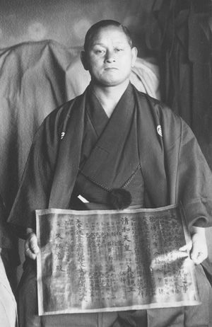 Takuma Hisa receiving his menkyo kaiden master teaching award from Sokaku Takeda in 1939