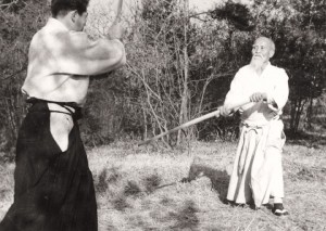 Morihei Ueshiba training outdoors in Iwama with Morihiro Saito, c. 1958