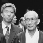 Current Doshu Moriteru Ueshiba with his father Kisshomaru Ueshiba, the Second Doshu, at the Aiki Taisai in Iwama, c. 1990