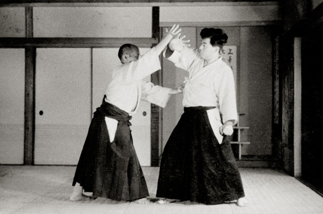 Aikido Founder Morihei Ueshiba demonstrating atemi prior to executing technique. Noma Dojo, 1936