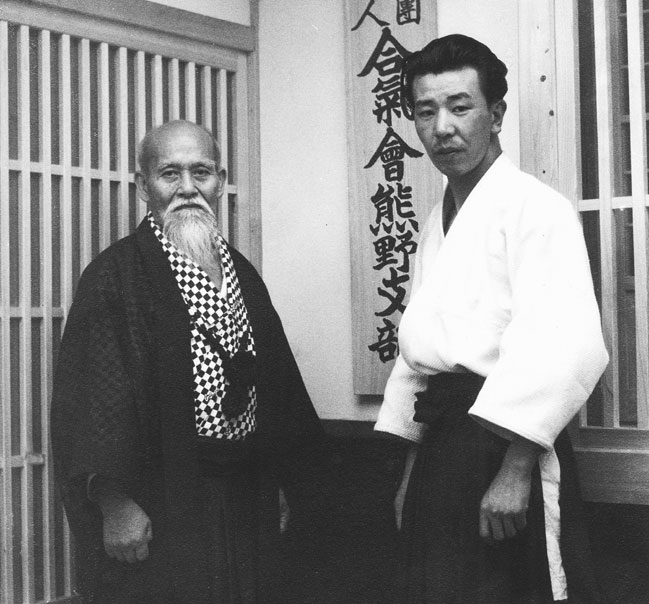 Founder Morihei Ueshiba with Michio Hikitsuchi in front of Kumano Juku Dojo c. 1953